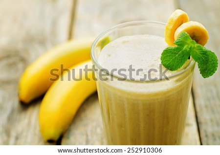 banana milkshake on a blue background. tinting. selective focus - stock photo