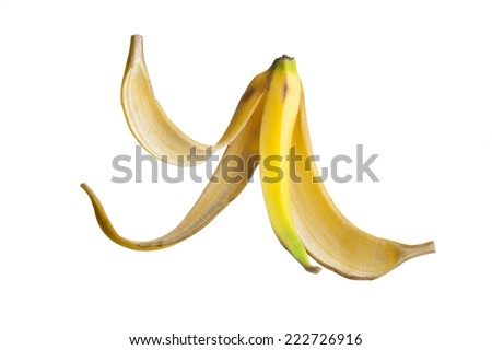 Banana peel floating on air against a white Background - stock photo