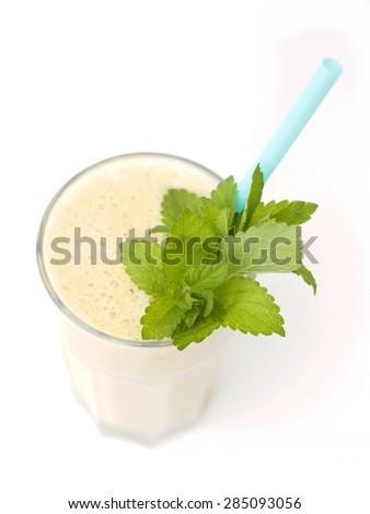 banana smoothie on a white background - stock photo