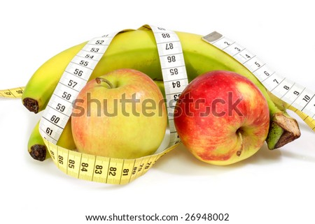 Bananas and apples with tape measure on bright background