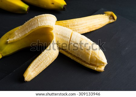 Bananas and peeled banana