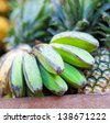 Bananas and pineapples on asian market - stock photo