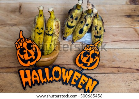 Bananas. Bananas-monsters  decoration at Halloween party on wood background.