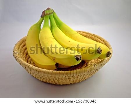 Bananas in a basket.  - stock photo