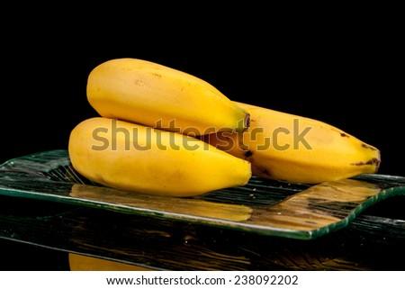 bananas on a black background - stock photo