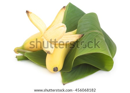 Bananas with green leaves on white background