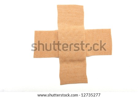 Band aid in a cross isolated on white, great concept of making things better