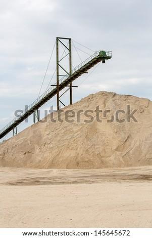 band-conveyor and sand workings  - stock photo