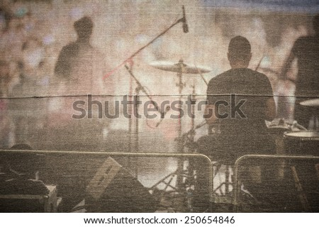 Band performing live on a stage, in front of huge crowd - stock photo
