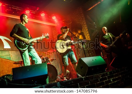 Band performs on stage, rock music - stock photo
