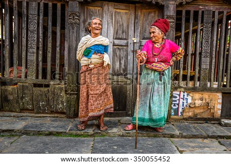 BANDIPUR, NEPAL - OCTOBER 22, 2015 : Two very old women discuss in the street of Bandipur in Nepal - stock photo