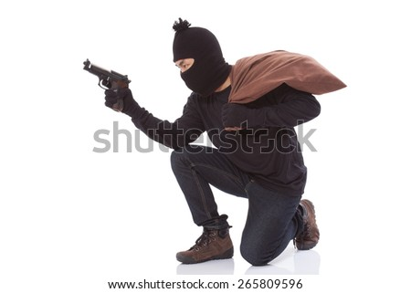 Bandit holding gun with bag on white background - stock photo