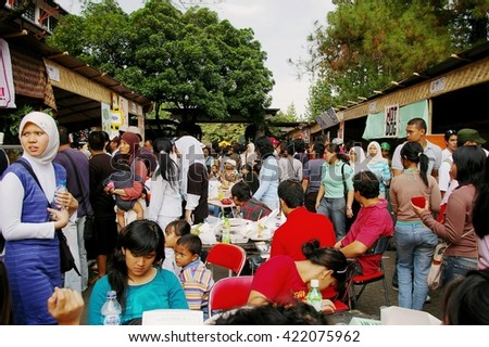BANDUNG, INDONESIA - SEPTEMBER 17, 2006: Crowded food stalls at art fair, Bandung, Indonesia.