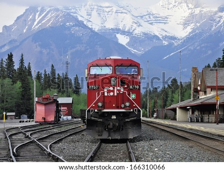 BANFF - JUNE 06: Freight train of Canadian Pacific Railway stands at Banff station on June 06, 2011 in Banff, Alberta, Canada.  - stock photo