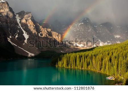 Banff Moraine Lake sunrise double rainbow - stock photo
