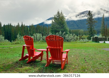 Banff national park with chairs andfoggy mountains and forest in Canada. - stock photo