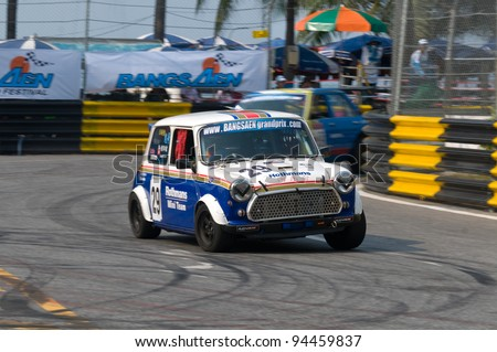 BANG SAEN - FEBRUARY 5: Vintage Mini sponsored by a tobacco brand racing during Bang Saen Speed Festival in Thailand on February 5, 2012. - stock photo