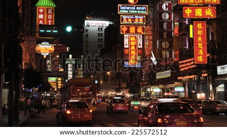 BANGKOK - APR 1: General View of Yaowarat Road in the evening on Apr 1, 2012 in Bangkok. Opened in 1891 in the reign of King Rama V, Yaowarat is a main street in Bangkok's Chinatown bustling district. - stock photo