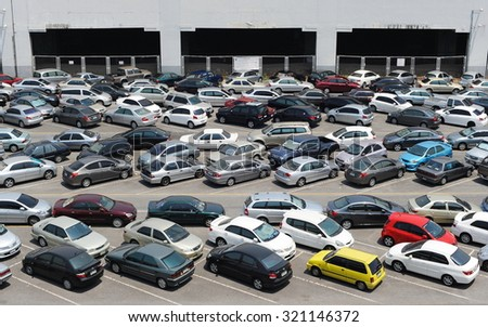BANGKOK - APR 5: View of cars at a park and ride lot at a BTS station in Chatuchak district on Apr 5, 2013 in Bangkok, Thailand. The government has promoted park and ride to reduce traffic congestion.