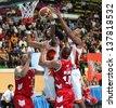 """BANGKOK - APRIL 24:Christien Charles participates in an ASEAN Basketball League """"ABL"""" at Nimitbut Stadium on April 24, 2013 in  Bangkok,Thailand.SMB beat SRTS 78-70 - stock photo"""