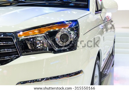 BANGKOK - APRIL 3 : Detail on the headlight of Ssangyong new Stavic in The 36 th Bangkok International Motorshow , on April. 3, 2015 in Bangkok, Thailand - stock photo