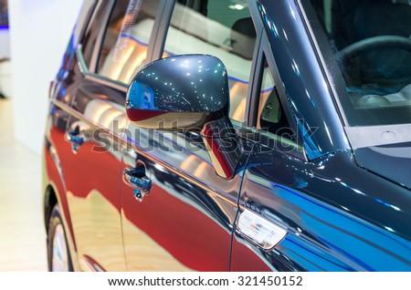 BANGKOK - APRIL 3 : Detail on the side mirror of Ssangyong new Stavic in The 36 th Bangkok International Motorshow , on April. 3, 2015 in Bangkok, Thailand - stock photo