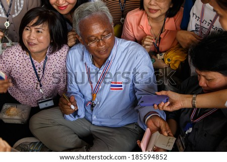 BANGKOK - APRIL 3 2014: Leader Suthep Meets supporters and signs autograph for protesters near Rama 8 Bridge in Bangkok, Thailand