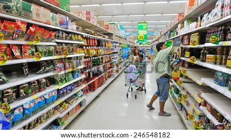 BANGKOK - APRIL 14: Shoppers browse a Tesco supermarket on April 14, 2013 in Bangkok, Thailand. Britain's Tesco is the world's third largest retailer after America's Walmart and France's Carrefour. - stock photo