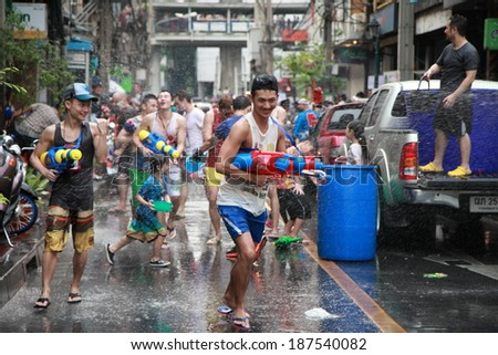 BANGKOK - APRIL 13: Stream of water over the crowd of people during celebrating the traditional Songkran New Year Festival, April 13, 2014, Silom road, Bangkok, Thailand.