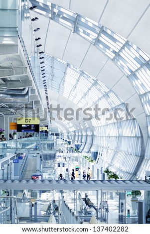 BANGKOK - APRIL 27: The main concourse of Suvarnabhumi Airport, designed by Helmut Jahn is the world's third largest single-building airport terminal on April 27, 2013 in Bangkok, Thailand. - stock photo