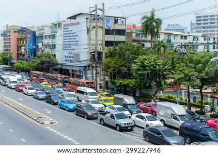 Bangkok - April 29: Traffic moves slowly along a busy road on April 29, 2015 in Bangkok, Thailand. Annually an estimated 150,000 new cars join the already heavily congested streets of Bangkok. - stock photo