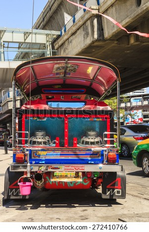BANGKOK - APRIL 20 2014: Tuk-tuk  motor taxi on the street in the Chinatown area   in Bangkok. Famous Bangkok moto-taxi called tuk-tuk is colorful a landmark of the city and popular transport. - stock photo
