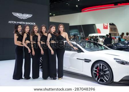 BANGKOK - April 3, 2015 : Unidentified model with Aston Martin car on display at The 36th Bangkok International Motor show on April 3, 2015 in Bangkok, Thailand.  - stock photo