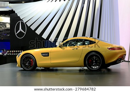 Bangkok - April 2 : yellow Mercedes Benz sport car 3-in display at The 36th Bangkok international Motor Show 2015 on April 2, 2015 in Bangkok Thailand - stock photo