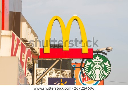 BANGKOK - ARIL 01, 2015: McDonalds logo and Starbucks Coffee logo in BANGKOK,THAILAND.McDonalds is the worlds biggest fast food chain. - stock photo