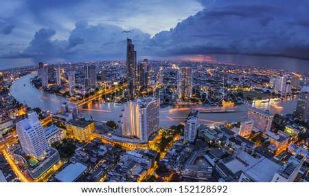 Bangkok at dusk with main river - stock photo