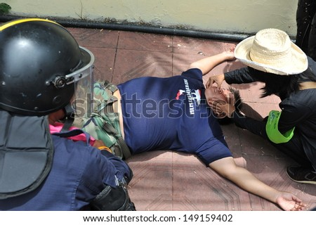 BANGKOK - AUG 7: A protester collapses after being arrested by police during an anti-amnesty rally near parliament on Aug 7, 2013 in Bangkok, Thailand.