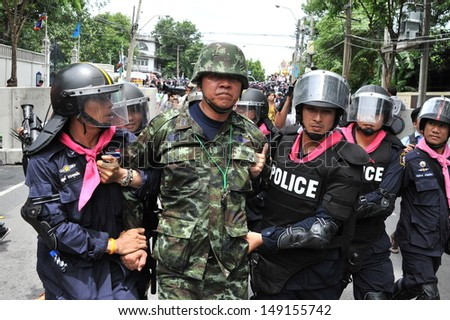 BANGKOK - AUG 7: Activist Capt Songklod Chuenchupol is arrested by police at an anti-amnesty bill rally near parliament on Aug 7, 2013 in Bangkok, Thailand.  - stock photo