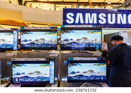 BANGKOK - AUG 11: TV display at Central Ladprao on Aug 11, 2014 in Bangkok. Samsung is a South Korean multinational conglomerate company headquartered in Samsung Town, Seoul. - stock photo