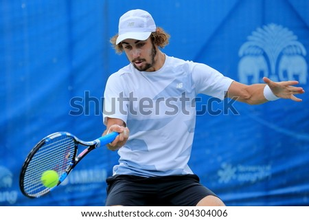 BANGKOK, AUGUST 8 : Jordan Thomson (AUS) action in Chang ITF Pro Circuit International Tennis Federation 2015 at Rama Gardens Hotel on August 8, 2015 in Bangkok, Thailand. He won in this match.