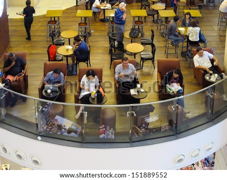 BANGKOK - AUGUST 13 : People doing different activities in the morning at Starbuck coffee shop on August 13, 2013 in Bangkok, Thailand. - stock photo