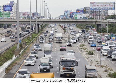 Bangkok - August 26, 2015: Traffic moves slowly along a busy road on August 26, 2015 in Bangkok, Thailand. Annually an estimated 150,000 new cars join the already heavily congested streets of Bangkok. - stock photo