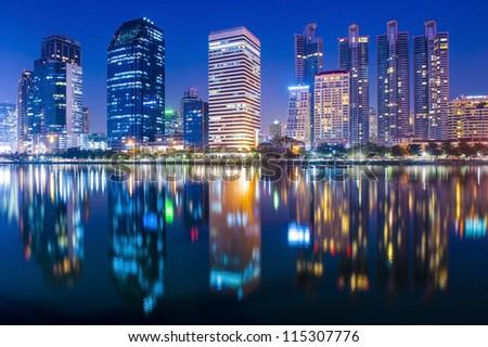 Bangkok city at night with reflection of skyline - stock photo