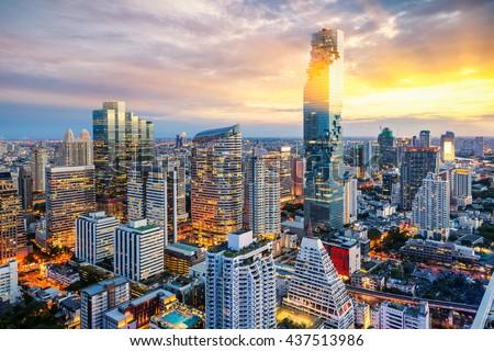 Bangkok city at sunset, Mahanakorn tower, Silom area, Thailand - stock photo
