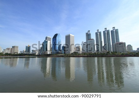 Bangkok city at twilight time with reflection of skyline and building - stock photo