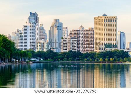 Bangkok city downtown at dusk with reflection of skyline, Bangkok,Thailand - stock photo