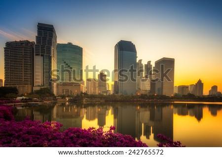 Bangkok city downtown at sunrise with reflection in Bangkok,Thailand - stock photo