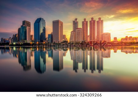 Bangkok city downtown at sunrise with reflection of skyline, Bangkok, Thailand - stock photo