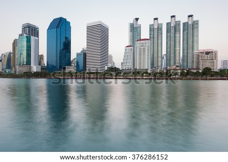 Bangkok city office skyline with water reflection