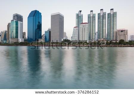 Bangkok city office skyline with water reflection - stock photo